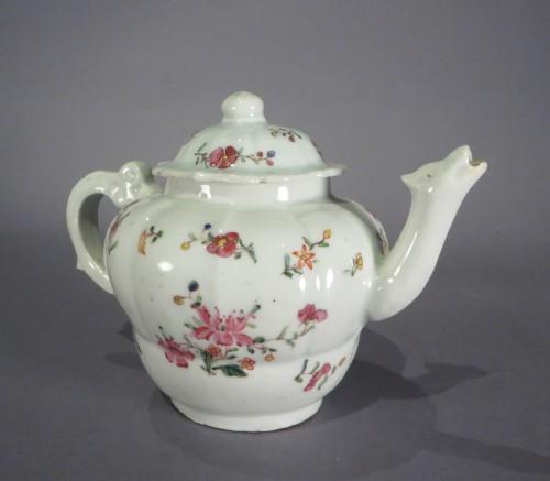Famille rose moulded teapot detail